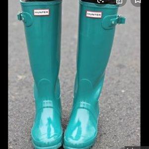 Tall turquoise Hunter rain boots